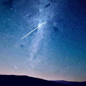 A meteor also known as a shooting star.